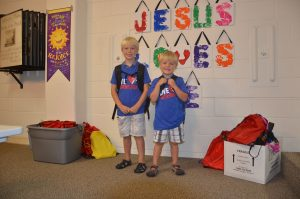 Landon and Owen with just a few of the School Kits.
