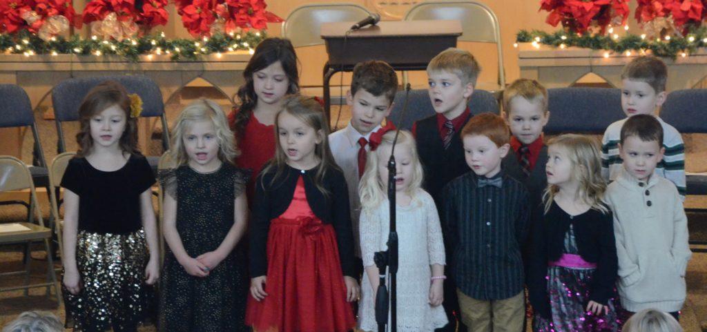 Little Baby Jesus, JESUS, Away in the Manger & Feliz Navidad by the Pre-school, Kindergarten, and First Grade.